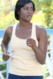 Exercício fêmea do African-American, funcionando Fotografia de Stock Royalty Free