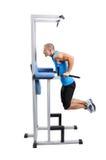 Exercício muscular do homem em um fundo branco imagem de stock