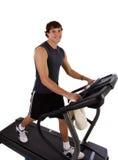 Exercício saudável do homem novo na escada rolante Fotografia de Stock Royalty Free
