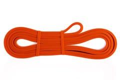 Exercez une bande élastique pour la forme physique et le yoga d'isolement photo libre de droits