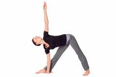 exercice适合的实践的女子瑜伽 免版税库存图片