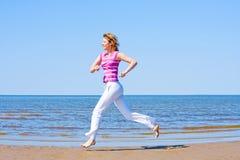 Exercice. Exercise on a sea shore Stock Photography