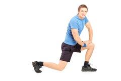 Exercice convenable d'homme de jeunes Photo stock