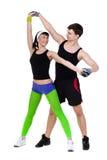 Exercice de couples de forme physique d'aérobic d'isolement dedans Photo libre de droits