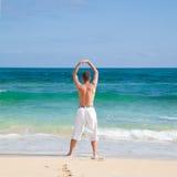 Exercice par le rivage Photo libre de droits