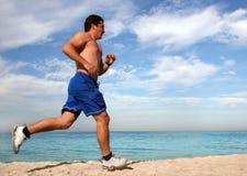Exercice sur la plage Images libres de droits