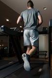 Exercice sur un plan rapproché de tapis roulant Photos stock