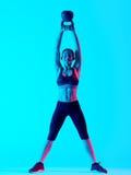 Exercices фитнеса колокола чайника женщины exercsing Стоковое Изображение RF