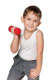 Exercices de matin avec des haltères Image stock