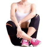 Exercices de sports d'espadrilles de guêtres de sports de jambes de femme Images libres de droits