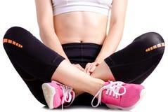 Exercices de sports d'espadrilles de guêtres de sports de jambes de femme Image stock