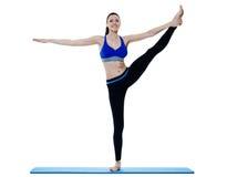 Exercices dei pilates di forma fisica della donna isolati Immagine Stock