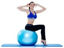 Exercices dei pilates di forma fisica della donna isolati Immagini Stock