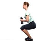 Exercices di posizione di Worrkout di addestramento del peso della donna Immagini Stock Libere da Diritti