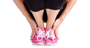 Exercices femelles de sports d'espadrilles de guêtres de sports de jambes Images libres de droits
