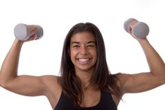 Exercise. Head and shoulders portrait of an attractive young woman in a pink tank isolated against a white background royalty free stock photo