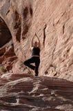 Exercise. A girl doing yoga in Red Rock Canyon, Las Vegas Nevada Stock Photos