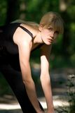 Exercise. Blond woman in nature - fitness royalty free stock images