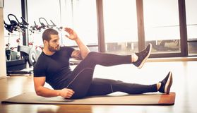 Exercise for abdominal muscle. Sports person. Young sportsman exercise abdominal muscle. Young sports person at gym royalty free stock photo