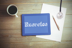 Exercise against high angle view of digital tablet and document with coffee Stock Image