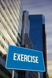 Exercise against low angle view of skyscrapers Royalty Free Stock Photography