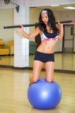 Exercise ball balancing Royalty Free Stock Images