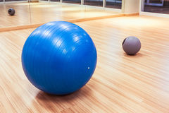 Exercise ball for fitness on wooden floor Stock Images