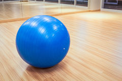 Exercise ball for fitness on wooden floor Royalty Free Stock Photos
