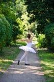 Exercise ballet. Young girl wearing tutu ballet and dancing in the garden. Exercise ballet Stock Photography