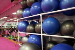 Exercise balls 2. Exercise balls sit on shelves waiting to be used Stock Image