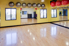 Exercise balls in gym. Silver and red exercise balls as seen in a club or gym Royalty Free Stock Photography