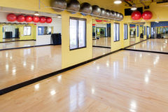 Exercise balls in gym. Silver and red exercise balls as seen in a club or gym Stock Images