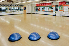 Exercise balls in gym. Bosu exercise balls as would be found in a gym or health club Royalty Free Stock Image