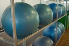 Exercise balls on rack in studio Royalty Free Stock Photo