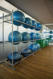 Exercise balls on rack in studio Stock Photography