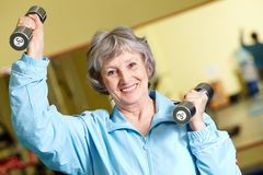 Exercise with barbells Royalty Free Stock Photos