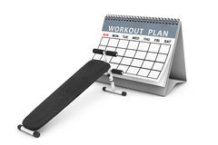 Exercise bench. Gym Equipment in front of Workout Plan Calendar. Stock Images