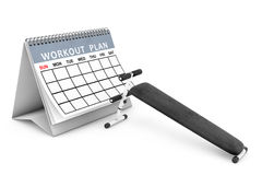 Exercise bench. Gym Equipment in front of Workout Plan Calendar. Stock Photo