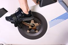 Exercise Bike 01. A close up of a foot and pedal on an exercise bike Stock Image