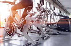 Free Exercise Bike Cardio Workout At Fitness Gym Royalty Free Stock Photography - 141355647