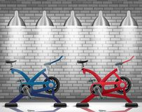 Exercise bike with light spotlight on brick wall texture background Royalty Free Stock Photos