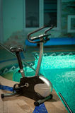 Exercise bike standing at swimming pool Stock Images