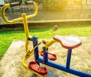 The exercise bike was installed on the cement floor next to the canal. Artificial sunlight . Royalty Free Stock Photos