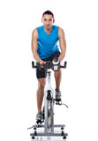 Exercise Bike. Young man exercising on a bike,  spinning exercise class Stock Photos