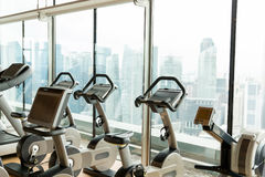 Exercise bikes in city gym Royalty Free Stock Photo