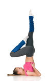 Exercise birch. Young happy woman does fitness exercise on white background exercise birch Stock Photos