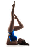 Exercise birch. Young  woman does fitness exercise birch, isolated on a white background Royalty Free Stock Photography