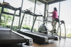 Exercise. Blurred of woman exercising at the gym on a cross trainer Royalty Free Stock Photography