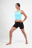 Exercise body shot of smiling athletic young woman Royalty Free Stock Photography