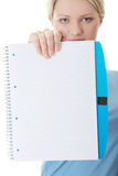 Exercise book. Student woman showing blank exercise book Stock Photo